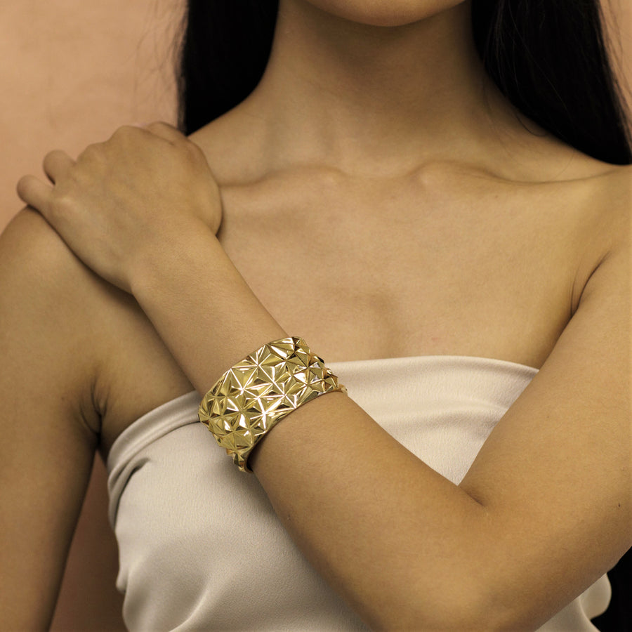 Girl wearing statement gold plated bracelet