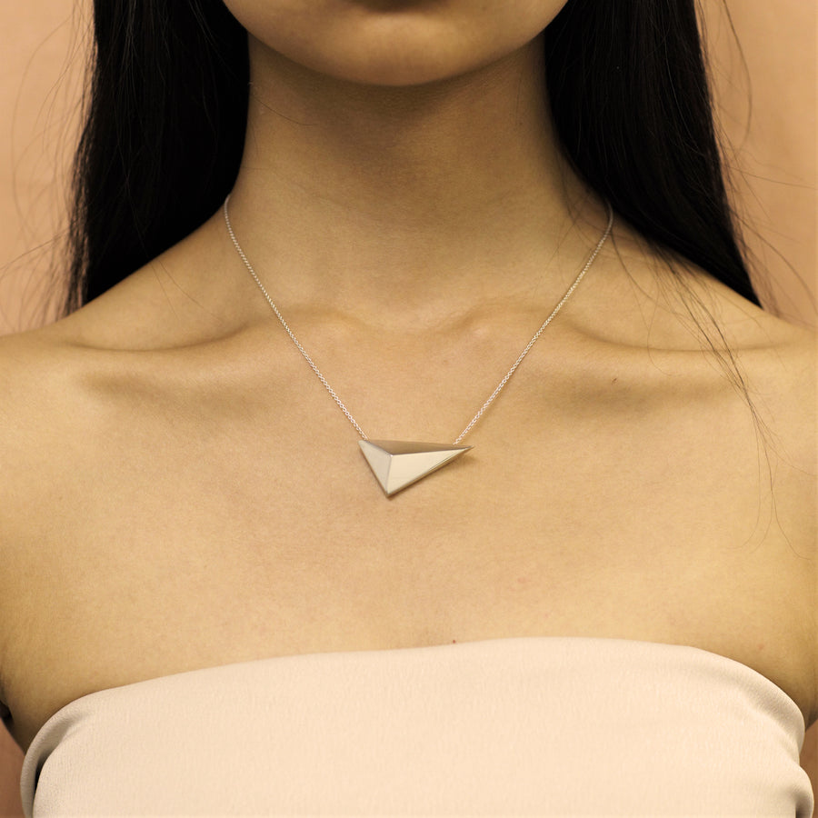 Girl wearing statement sterling silver pendant