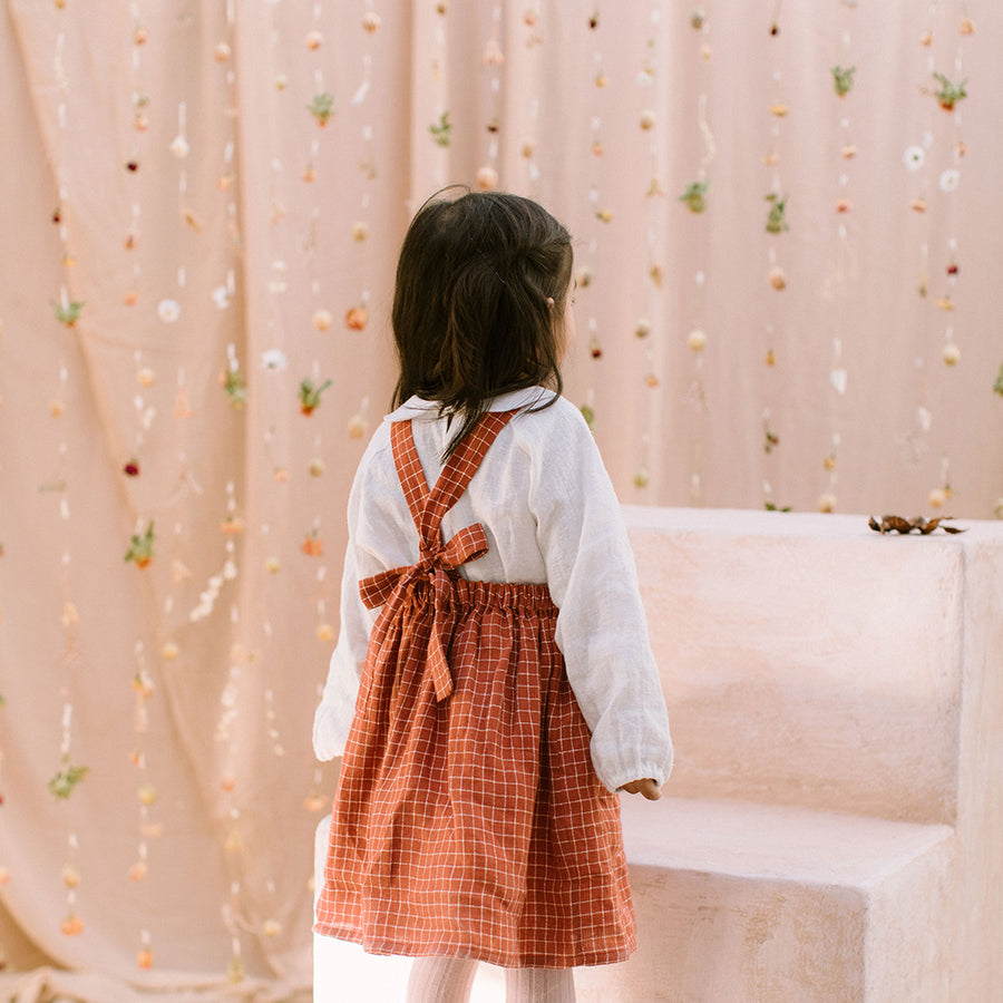 Nellie Quats :: Conkers Pinafore Rust Check Linen