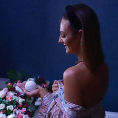 Lusso Tan Co founder lynsey bennett in a bath robe holding the new Lusso Tan Bath Bomb