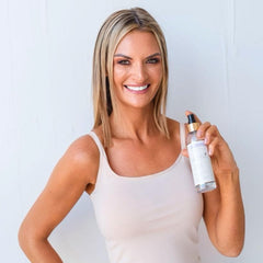 Co founder Lead at a recent photo shoot holding Lusso Tan Primer