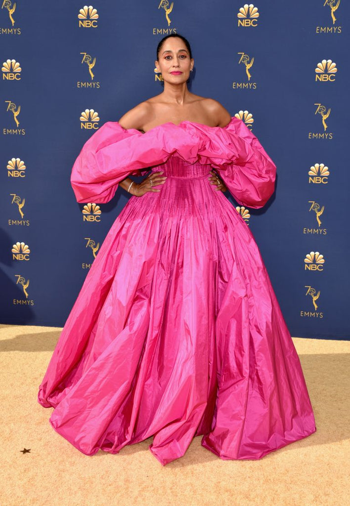 Tracee Ellis Ross in voluminous Valentino hot pink off the shoulder gown at the 2018 Emmy Awards on the red carpet, best dressed