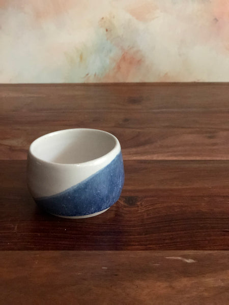 Small diagonal blue-dipped white acorn bowl
