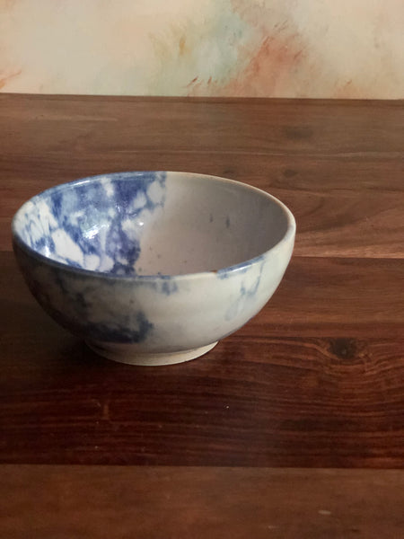 Small blue bubble-glazed white bowl