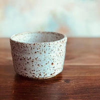 Iron flecked lidless sugar bowl
