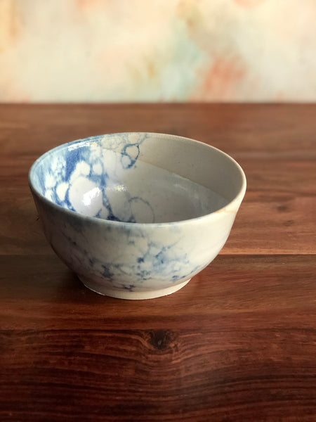 Diagonal white and blue bubble-glazed rice bowl
