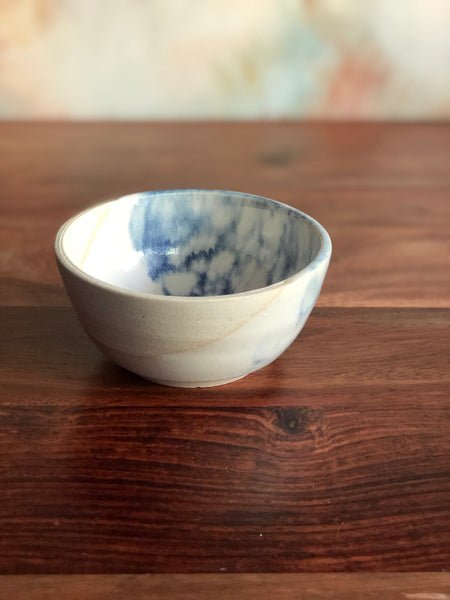 Small diagonal blue bubble-glaze bowl