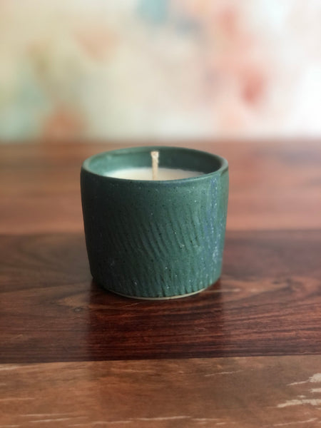 Chattered green candle cup