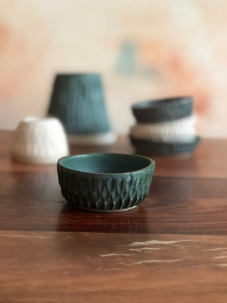Tiny bowls or salt cellars