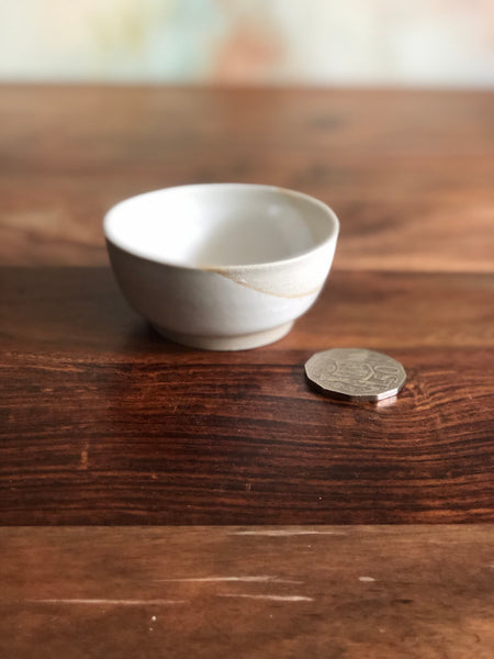 Diagonally dipped white salt dish