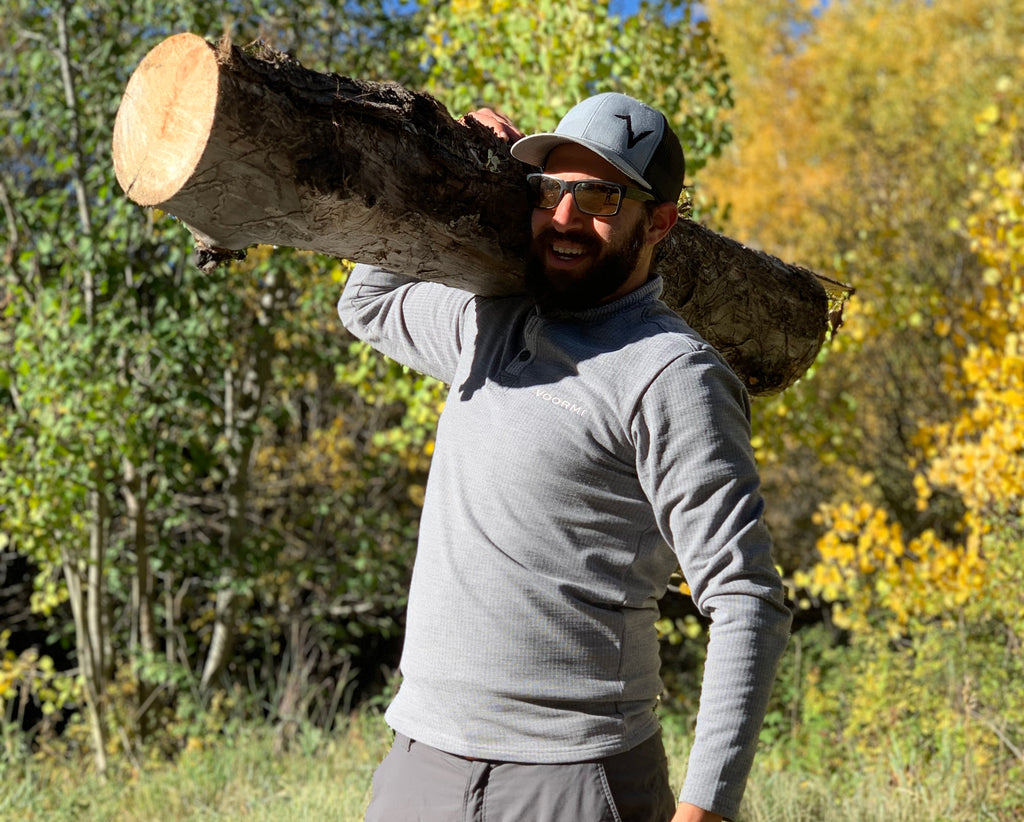 Carrying wood in the Voormi men's high country henley