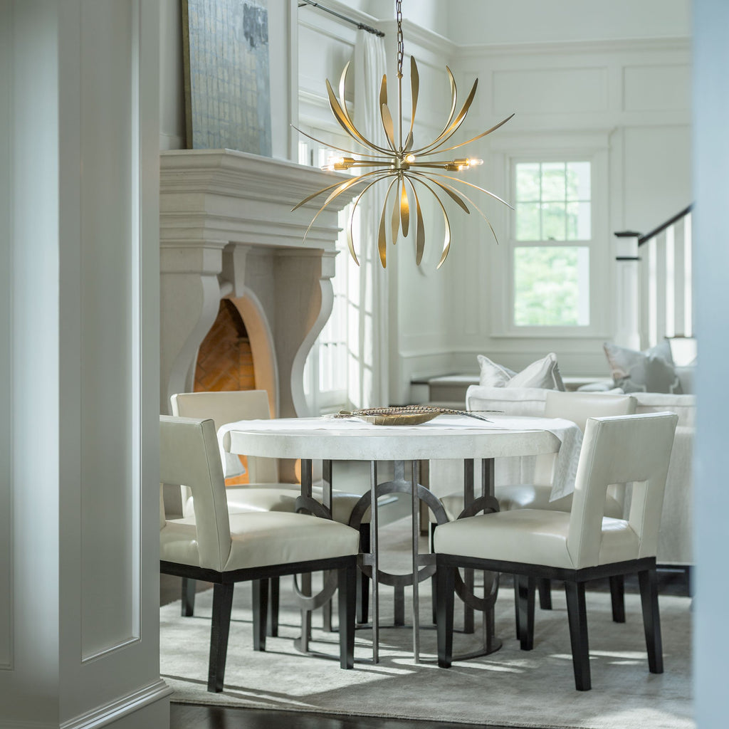 Dahlia Chandelier in Gold haniging over dining table, hubbardton forge