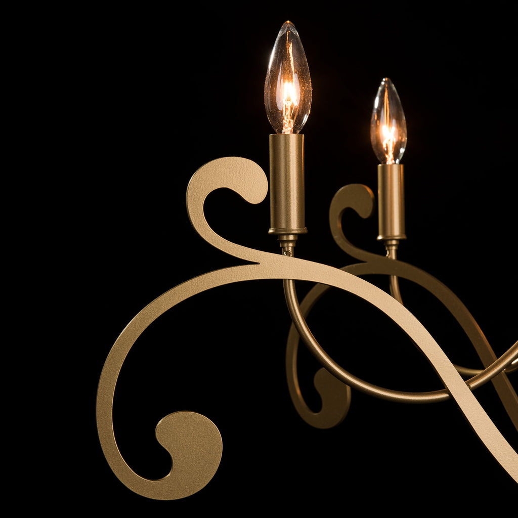 Scroll and lamping details of Bella 6 arm chandelier from Synchronicity
