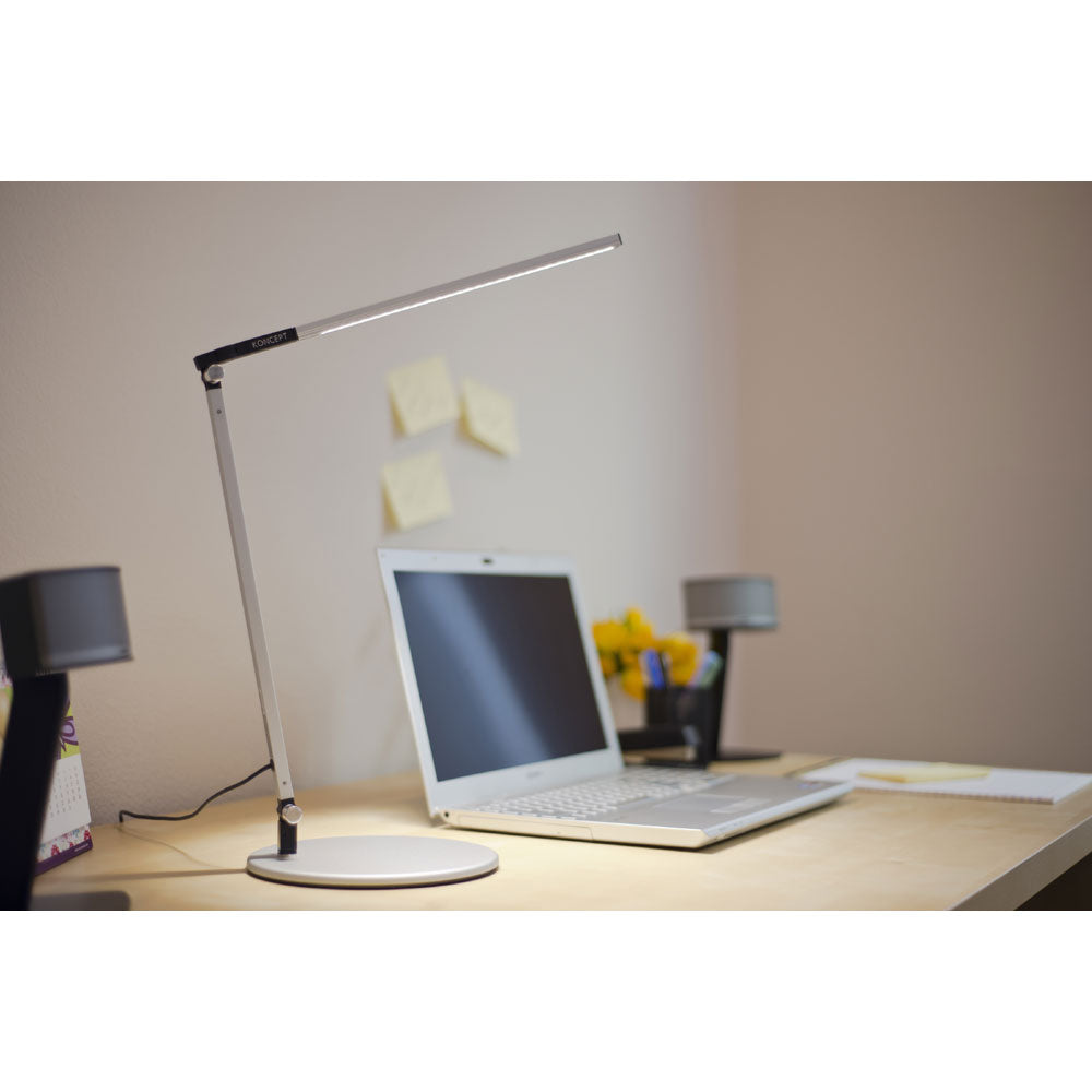 z-bar solo mini LED desk lamp in silver on desk lighting a laptop, koncept lighting