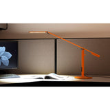 ORANGE EQUO DESK LAMP ON DESK IN CUBICLE