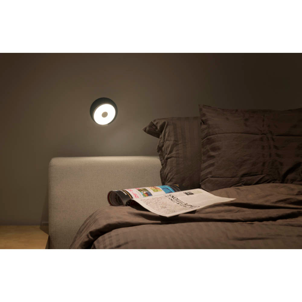 KONCEPT GRAVY WALL SCONCE ABOVE HEADBOARD AS READING LIGHT