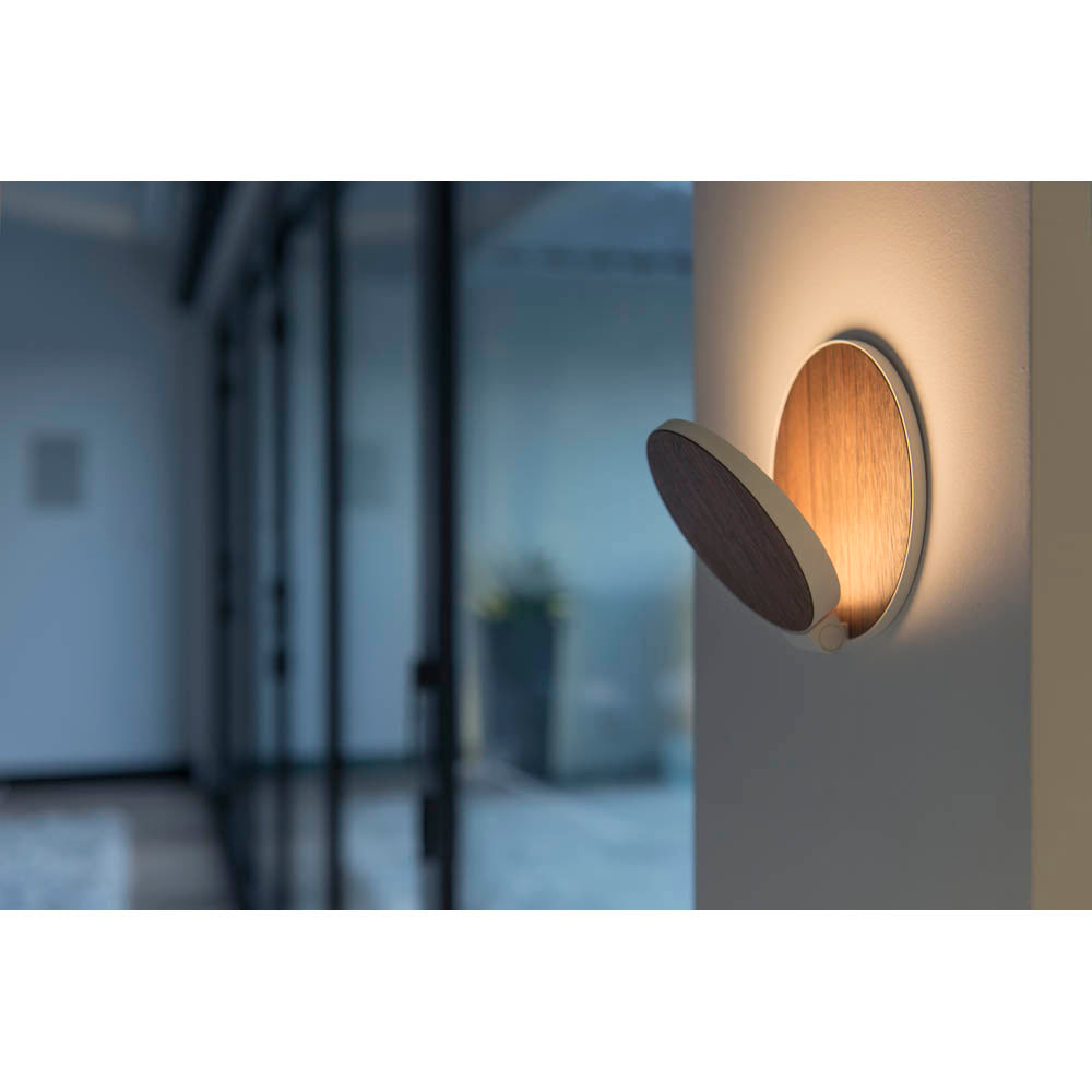 GRAVY LED WALL SCONCE IN OILED WALNUT LIT ON WALL