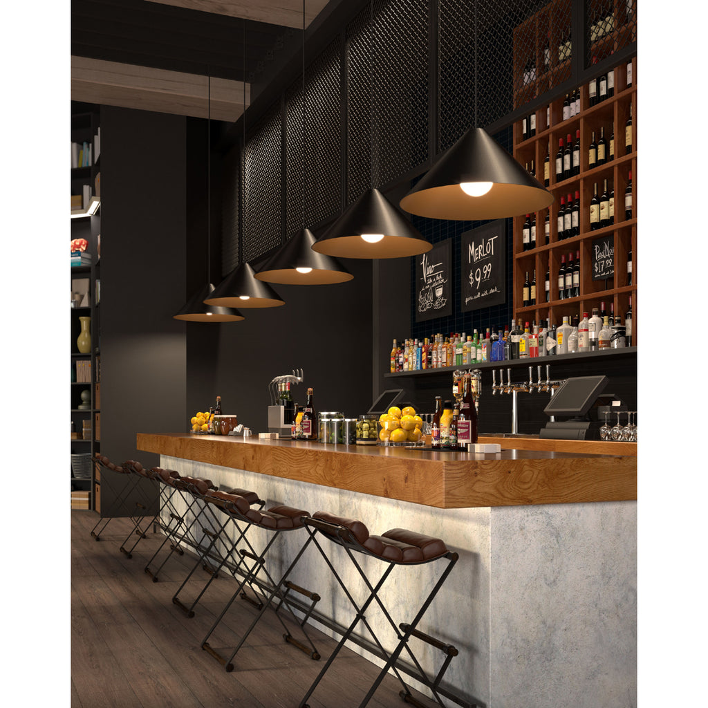 five black and satin gold finished Konos pendants from tech lighting hanging over a bar