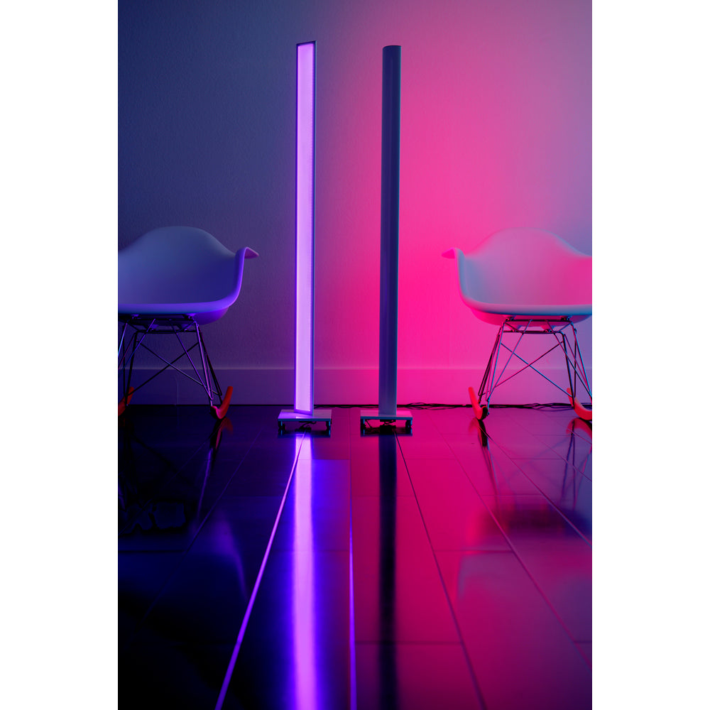Tono LED floor lamp lighting a room in pink