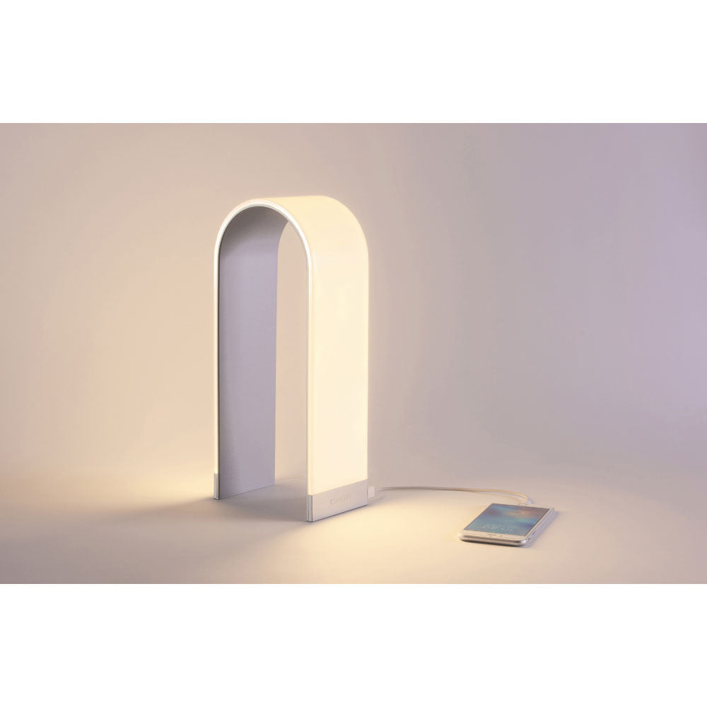 Mr. N tall by Koncept lighting charging a mobile phone