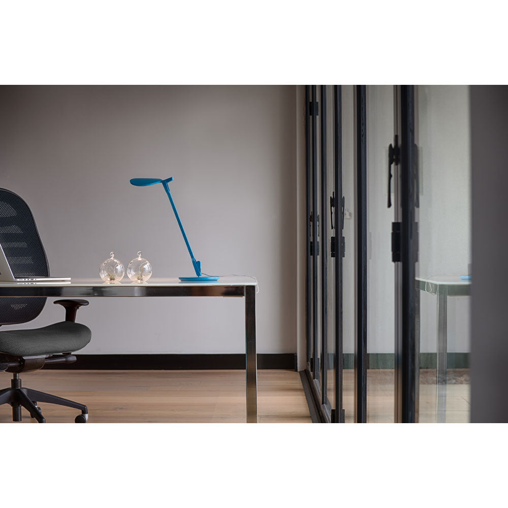 matte pacific blue splitty desk lamp lighting a desk
