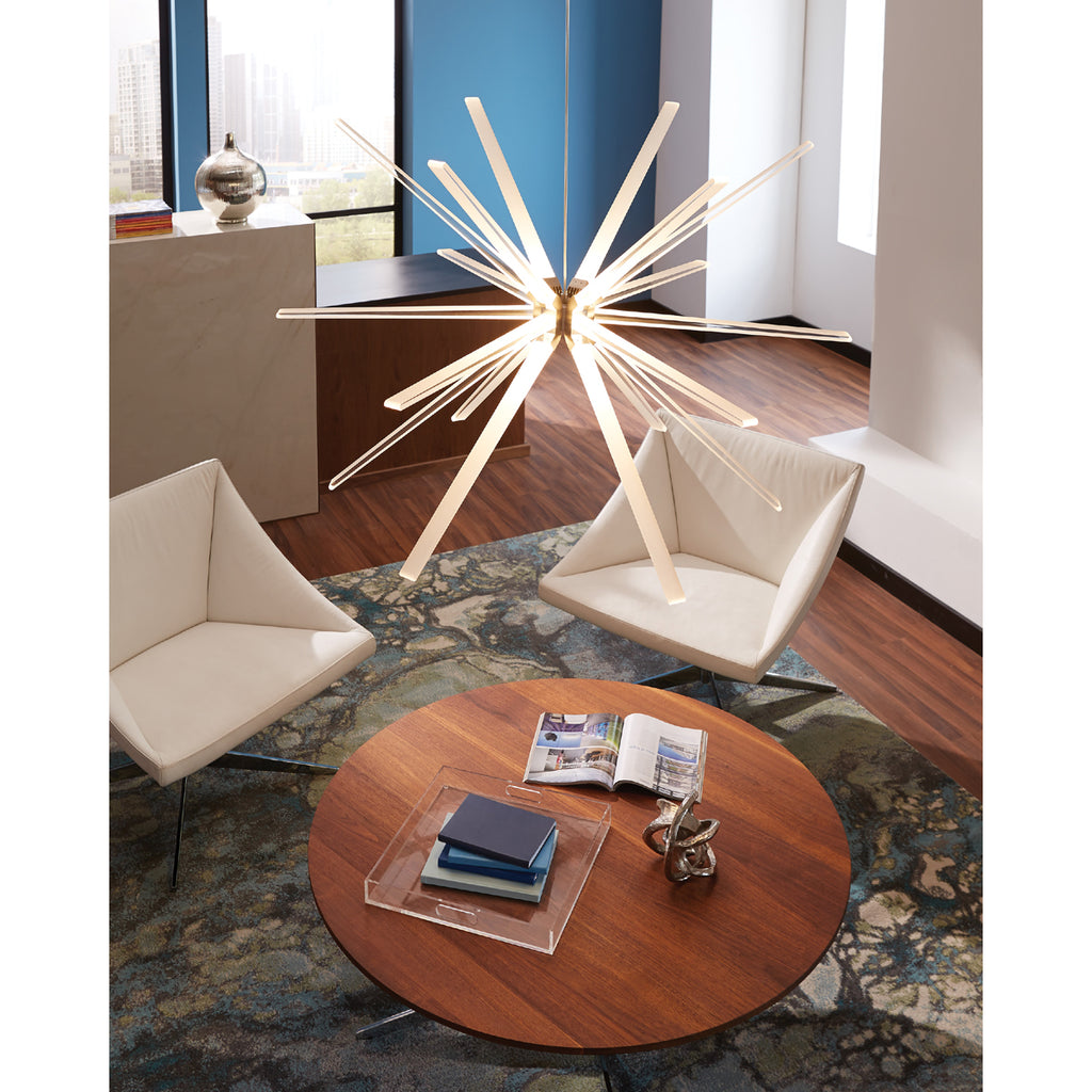 Photon LED large pendant hanging over a round wooden coffee table
