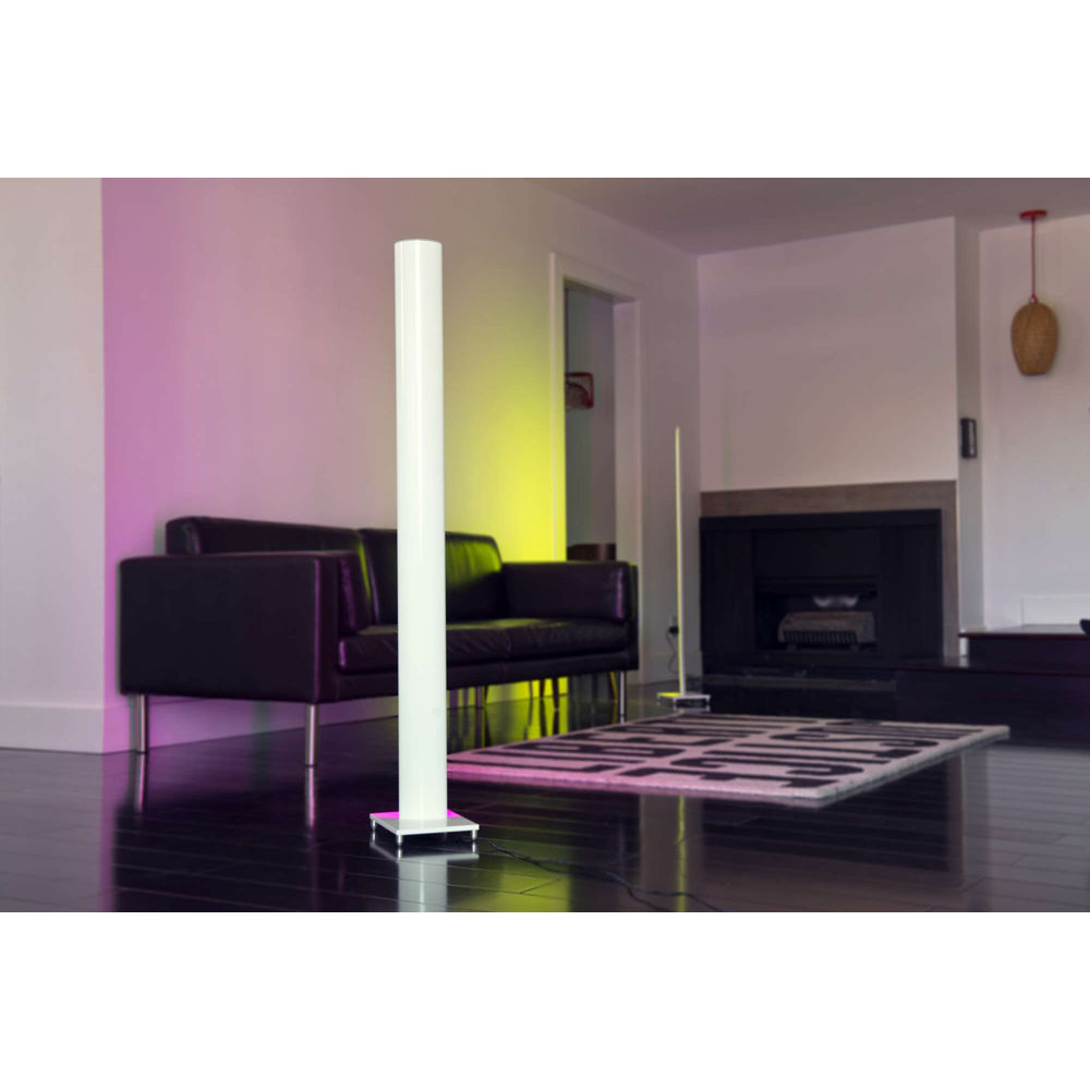 Tono LED floor lamps lighting a living room in pink and yellow light