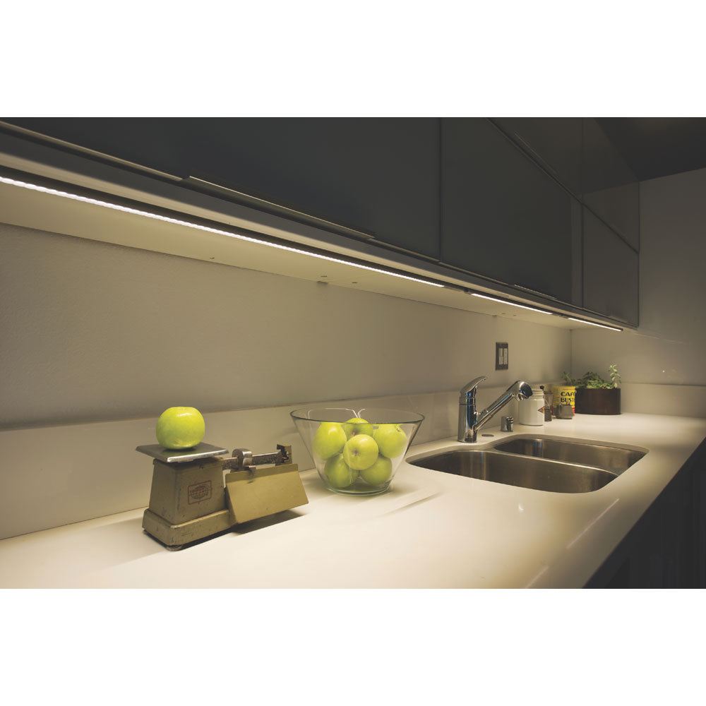 UCX under cabinet lighting in kitchen lighting counter top with green apples on it