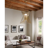 syrma grande pendant in satin gold hanging over coffee table in living room