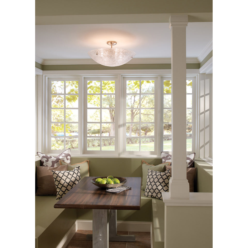 trace semi flush ceiling light hanging over table with banquet seating