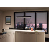zhane linear pendant in black rubberized finish hanging over a kitchen island