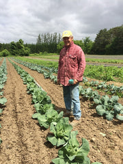 A farmer at Rideau Pines Farm