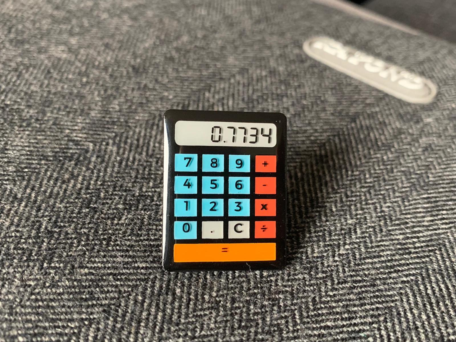 0.7734 Calculator Pin Badge