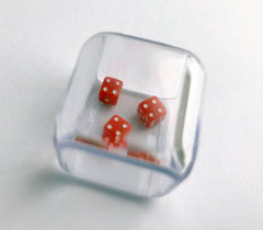 Three identical dice in a cube