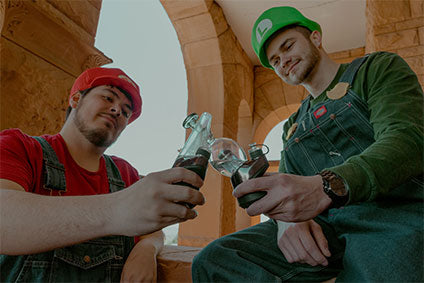Mario and Luigi share a Puffco Peak