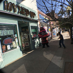 Myxed Up Mushroom dances in front of the Myxed Up Pueblo store.