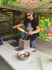 Sandman doing a live glassblowing demonstration at Myxed Up Aurora.