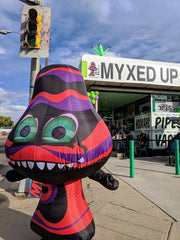 Giant Mushroom stands outside of Myxed Up Denver