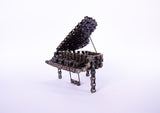Piano - Piano sculpture, made of bicycle chains