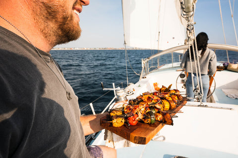 Chef Tim Hollingsworth sailing and cooking Seatopia Collars