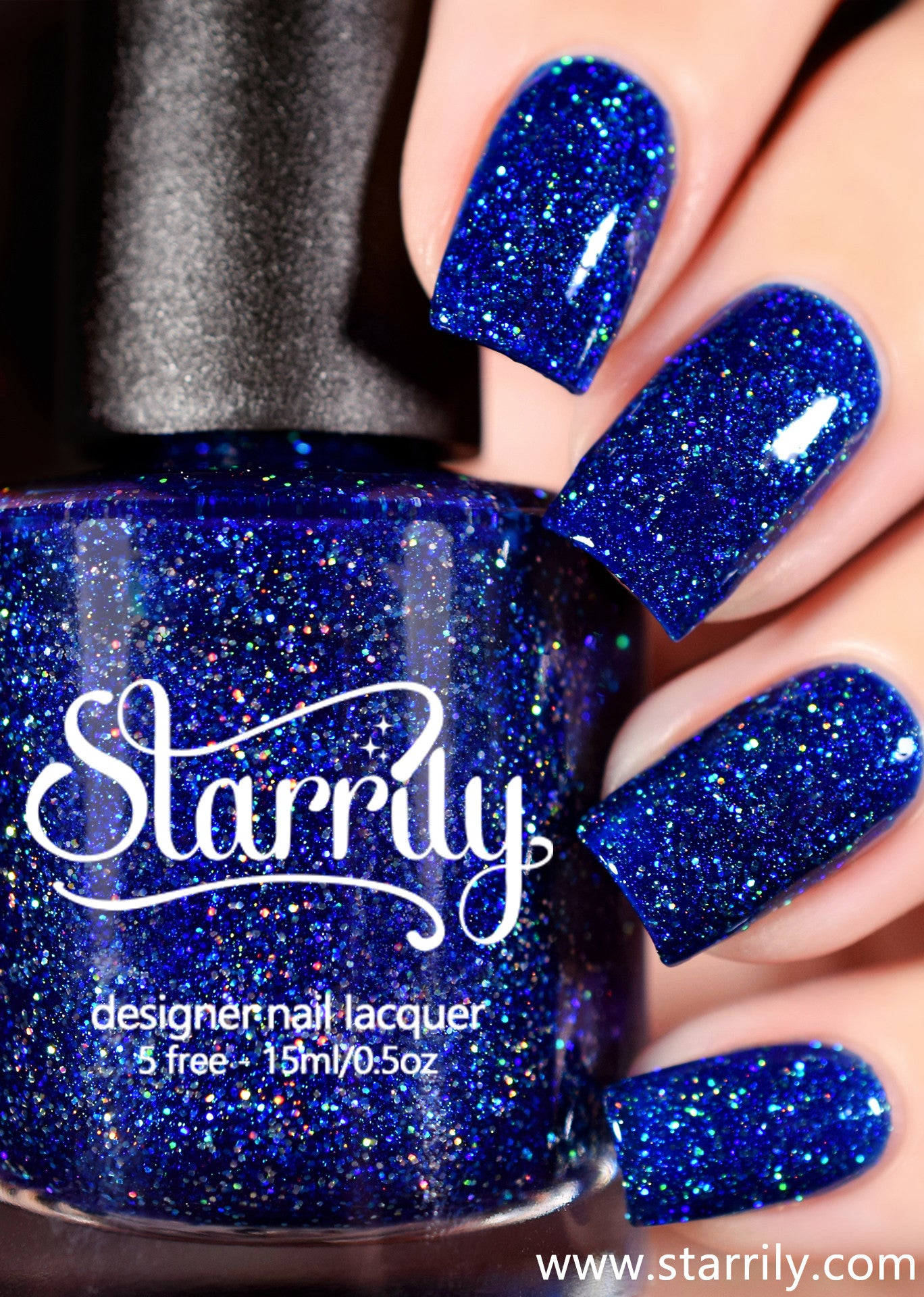 Starrily Bioluminescence - Rich sapphire blue with holographic glitter and a holo effect. High quality nail polish. Made in the USA! Cruelty Free and Vegan.