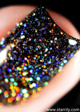 Beautiful blackened gray holo nail polish with holographic glitter