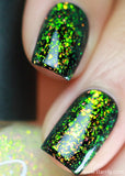 Enigma is a green color shifting iridescent topper with magical flakes