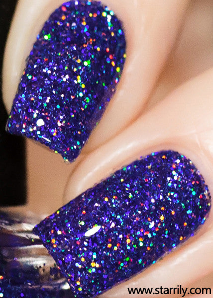 Orions Belt is a stunning nail polish containing sparkling purple holographic glitter