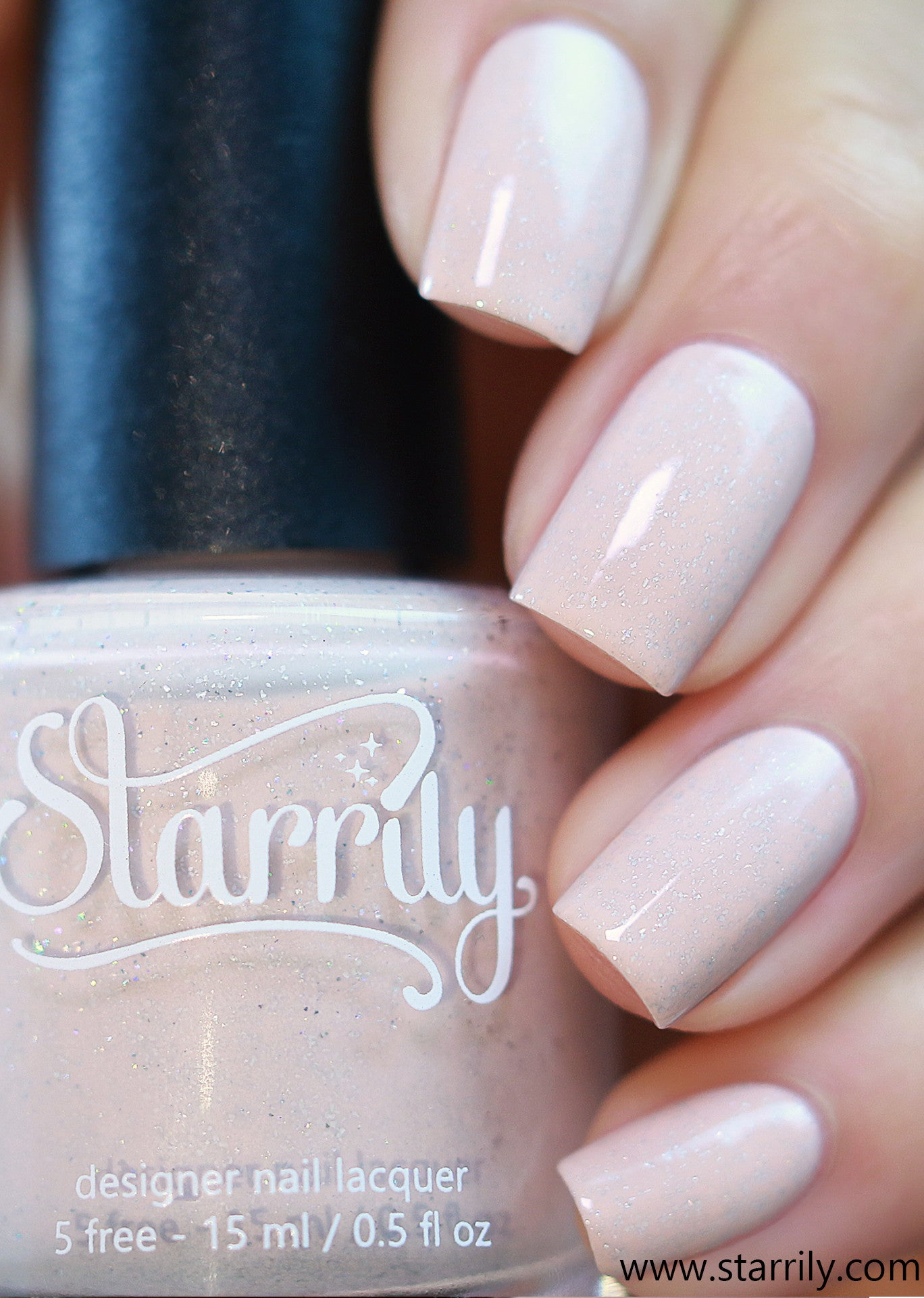 Ortley Beach is a stunning peach nude nail polish with holographic flakes