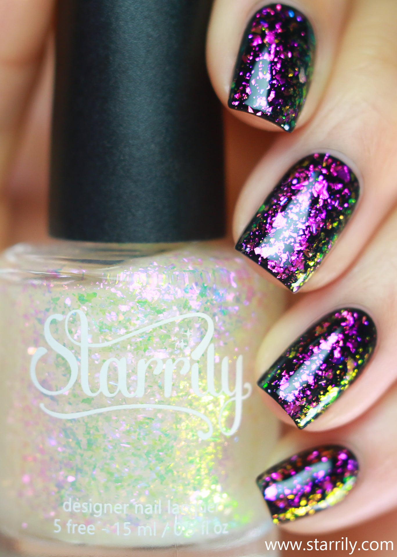Pandoras Box is an iridescent multichrome flake nail polish that shifts from pink red and gold
