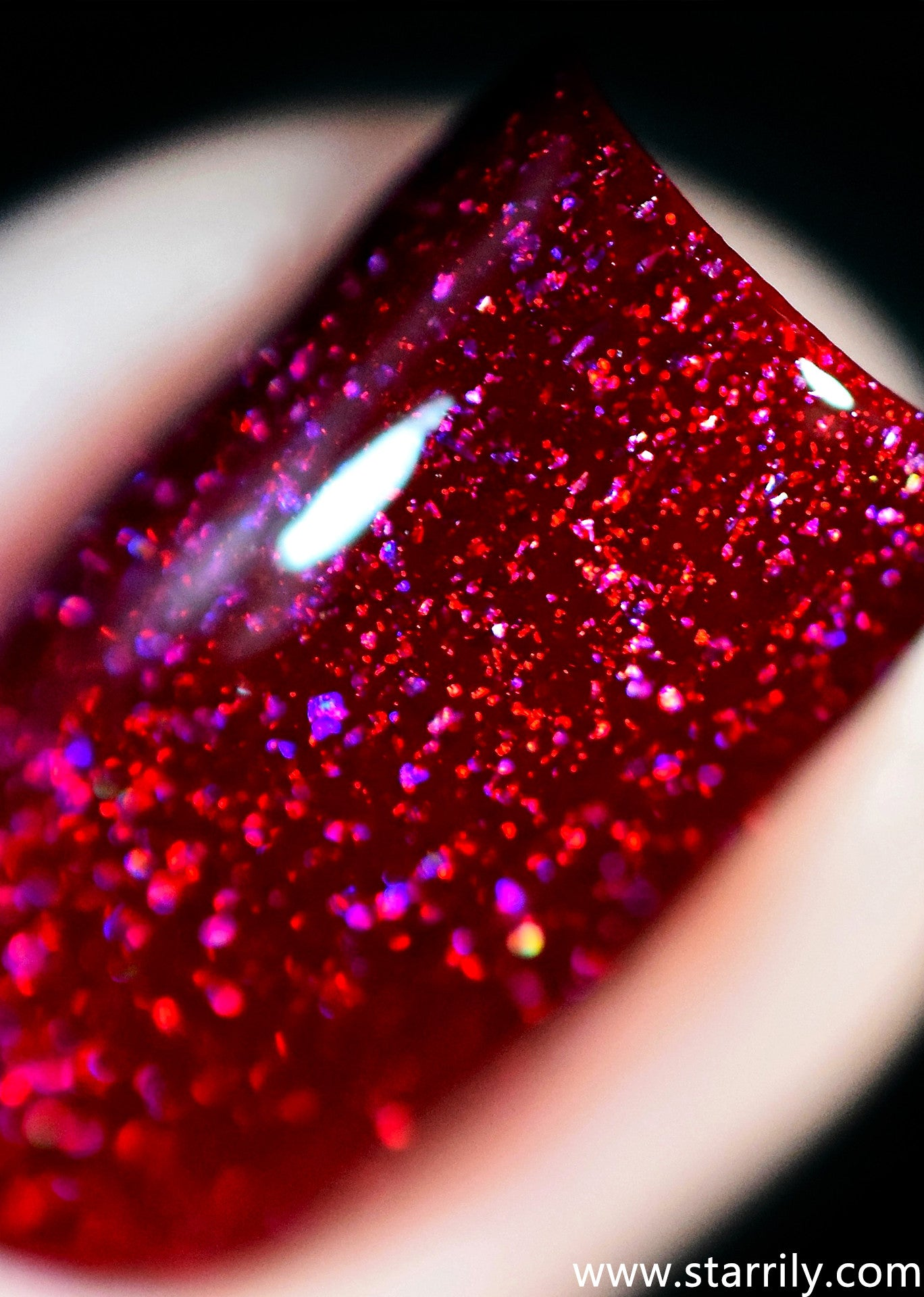 Serotonin is an amazing red jelly nail polish with holographic flakes