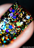 Christmas Lights is a nail polish jam packed with golden and rainbow colored glitters