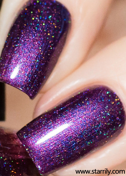 Hotel Transylvania is an amazing purple nail polish with holographic flakes