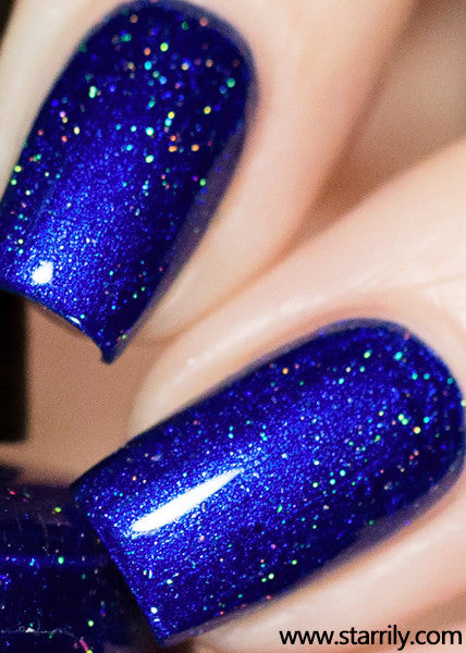 Heart of the ocean is a beautiful sapphire blue nail polish with holographic flakes